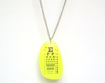 Neon yellow eye chart pendant and chain made from prescription Rx lens