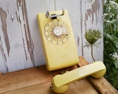 Vintage sunshine lemon yellow rotary wall phone by Western Electric