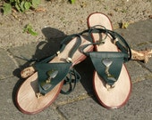 Sandals, all leather dark green, with 2 metal hearts on the top connected by 3 chains. OOAK handmade with an ankel bands.
