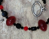 Black and Red and Striped all Over - Black Faceted Swarovski, lightweight red/black Glass beads, Antique Silver clasp