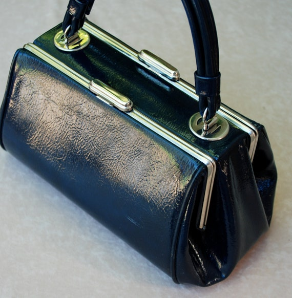 Navy and silver patent leather purse, doctor or barrel bag style with double compartments.