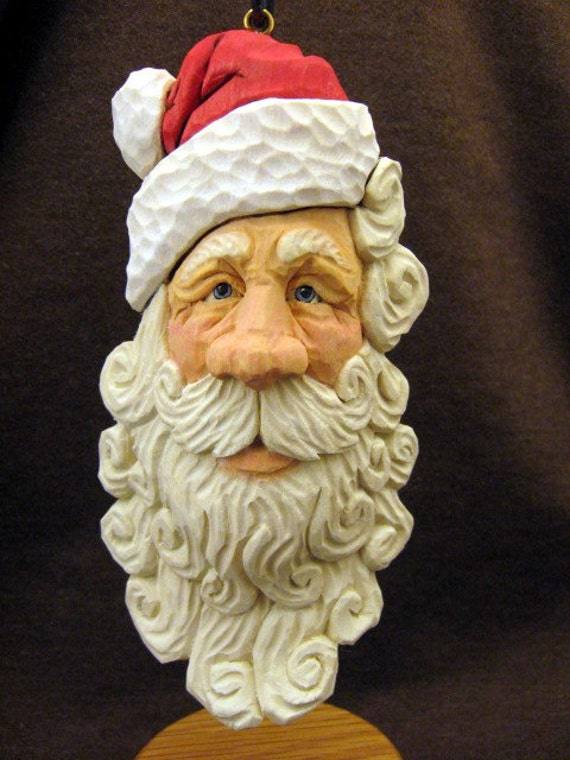 Detailed hand carved wood santa ornament