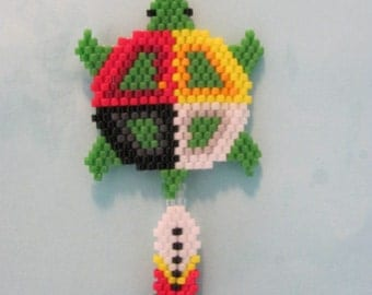 Hand Beaded Medicine Wheel turtle with feather dangling earrings