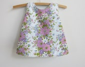 Upcycled baby dress or pinny, 70 style A line, size 000, 0 - 3 months, mauve, pink purple and white flowers green leaves eco kid