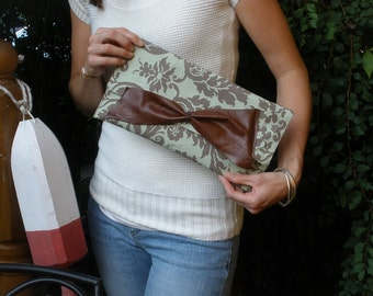 Chocolate to Go Aqua Clutch with Oversized Milk Chocolate Leather Bow. Handmade in Canada.