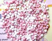 20 grams of White and Lt Pink 6mm Acrylic stars  (about 300 pcs)