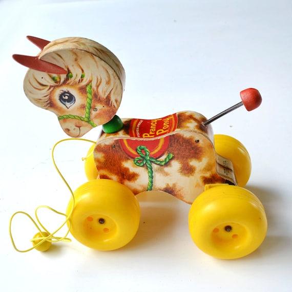 Vintage Fisher Price Prancy Pony Wooden Pull Horse toy  offered by Elizabeth Rosen
