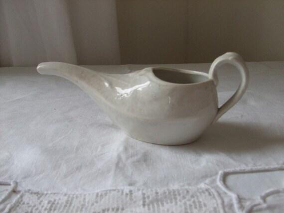 Vintage French old porcelain feeding duck.