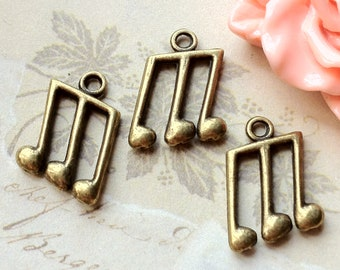 11 x 15 mm Antique Bronze Music Note Metal Charms (.tu)