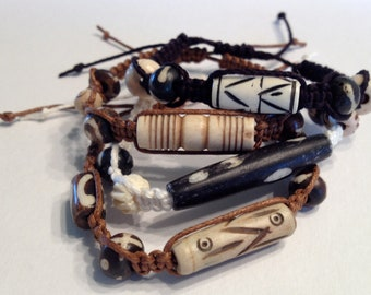 Tribal Bracelets - Assorted Bone Beads on Off-White, Black, and Tan Cord