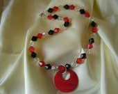 Bead necklace with red pendant