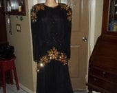 Heavily beaded and sequined ballroom gown by Destinee