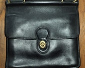 Vintage Coach Black Leather Purse with solid brass accents in Great Condition, however it is missing the shoulder strap