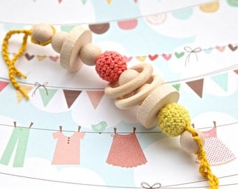 Coral and yellow big teething rattle for baby boy. Natural wooden toy with organic cotton. Ready to ship.