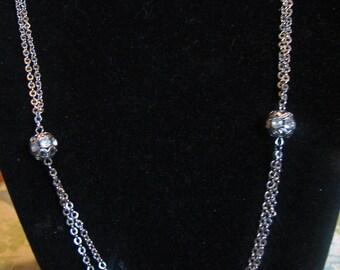 Elegant, trendy, timeless - Sarah Coventry signed silver tone necklace and bracelet set.