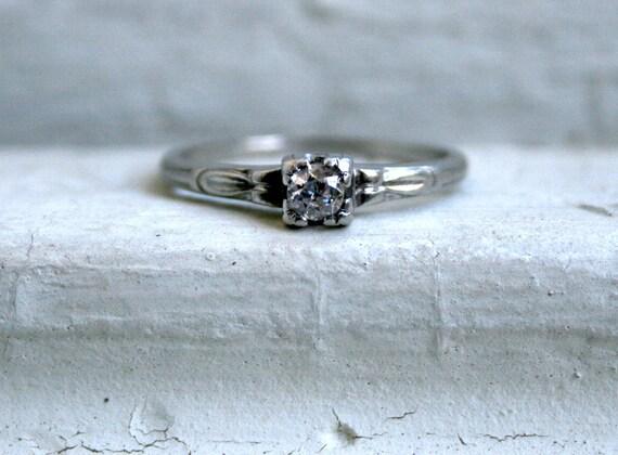 Classic Vintage Platinum Diamond Solitaire Engagement Ring.