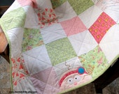 Pink and Green Patchwork Baby Girl Quilt, appliqued with a sweet little girl.