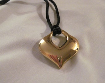 Golden heart necklace on black cord