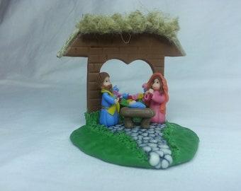 Miniature Nativity. Mary, Joseph and baby Jesus