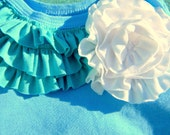 The Beach bum. An Aquamarine baby onesie with Turquoise Ruffles and large White ruffle flower. Size 6 months