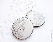 White earrings with abstract ornament