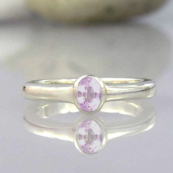 taaffeite ring - rarest gemstone ring in the world - light pink color
