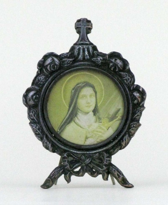 an old small  french photo frame with Ste. Bernadette