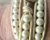 White matte crystal pearl beaded bracelet with  genuine white leather and silver button closure
