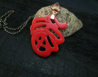 red coral carved and sterling silver pendant