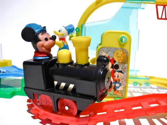 Mickey mouse turn over choo choo for Disney mickey mouse motorized choo choo train with tracks