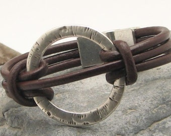 EXPRESS SHIPPING Women's leather  bracelet. Brown multi strap leather bracelet with silver plated  textured donut ring and magnetic  clasp.