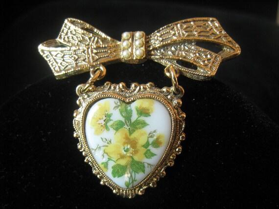 SALE Vintage filigree look Bow Brooch with hanging Floral design Heart Drop
