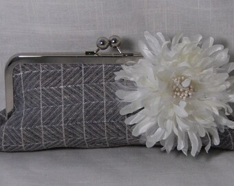 Gray windowpane linen clutch with white mum flower pin