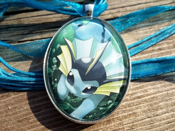 Vaporeon Glass Pendant made from Trading Cards
