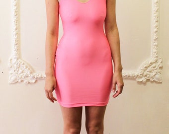 form-fitting neon pink dress
