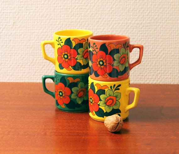 Vintage Four brightly colored cups with flowers