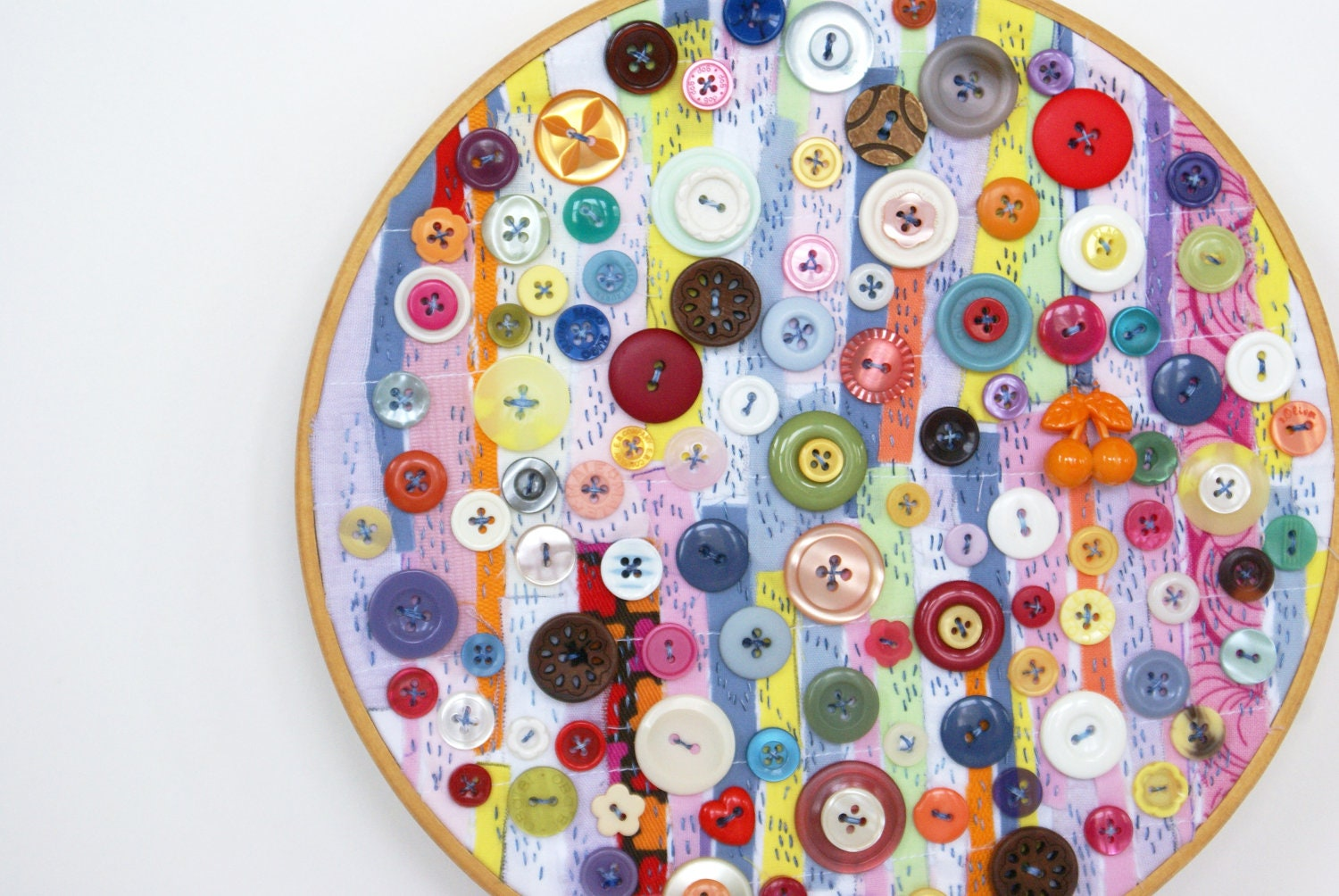 Upcycled embroidery hoop art textile and vintage button