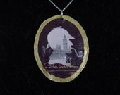 The Sherlocks of London (gold border, sepia-toned, double-sided reclaimed book silhouette pendant)