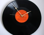 """Johnny Cash Vinyl Record CLOCK made from recycled 12"""" album, """"America"""". Great orange and black colors.  Cool retro look..."""
