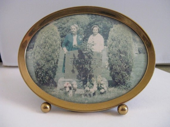ANTIQUE standing oval brass frame w round feet old photo