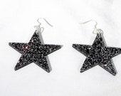 Black glitter star acrylic drop earrings