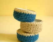 Tea candles with crocheted cozies