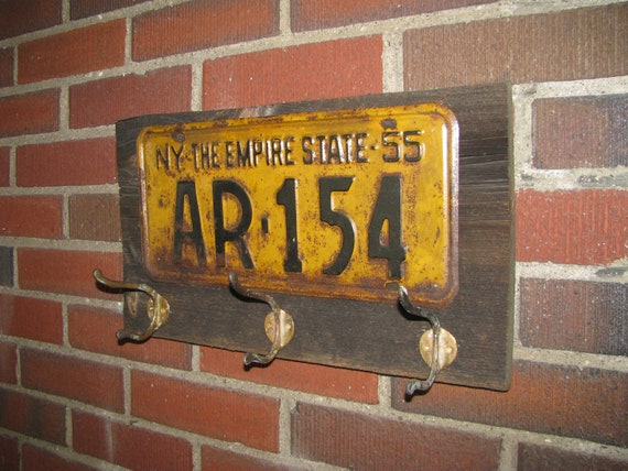 Vintage coat rack made with a real vintage license plate- Fathers Day-barnwood- and vintage brass hooks- NEW YORK