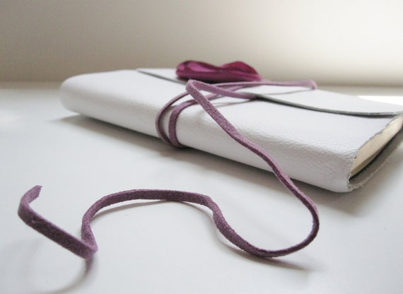 medium soft white leather journal with purple wrap closure and flower embellishment
