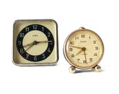 Set of two sovietic non working Clocks - russian Mom and Slava vintage alarm mechanical clocks red black