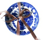 White and blue vintage porcelain plate - set of two painted plates - brown bow