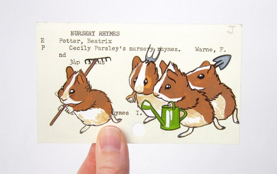 Beatrix Potter Cecily Parsley's Nursery Rhymes - Print of the Gardening Guinea Pigs painted on library card