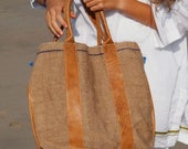 Leather bag, natural dye, and whole weaved jute hand made.
