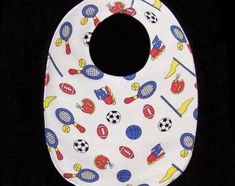 Baby Bib Sporty features tennis rackets, footballs, basketballs, roller skates and soccer, BB028