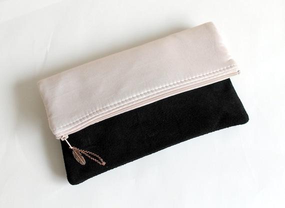 Fold over clutch, metallic look fabric, black suede